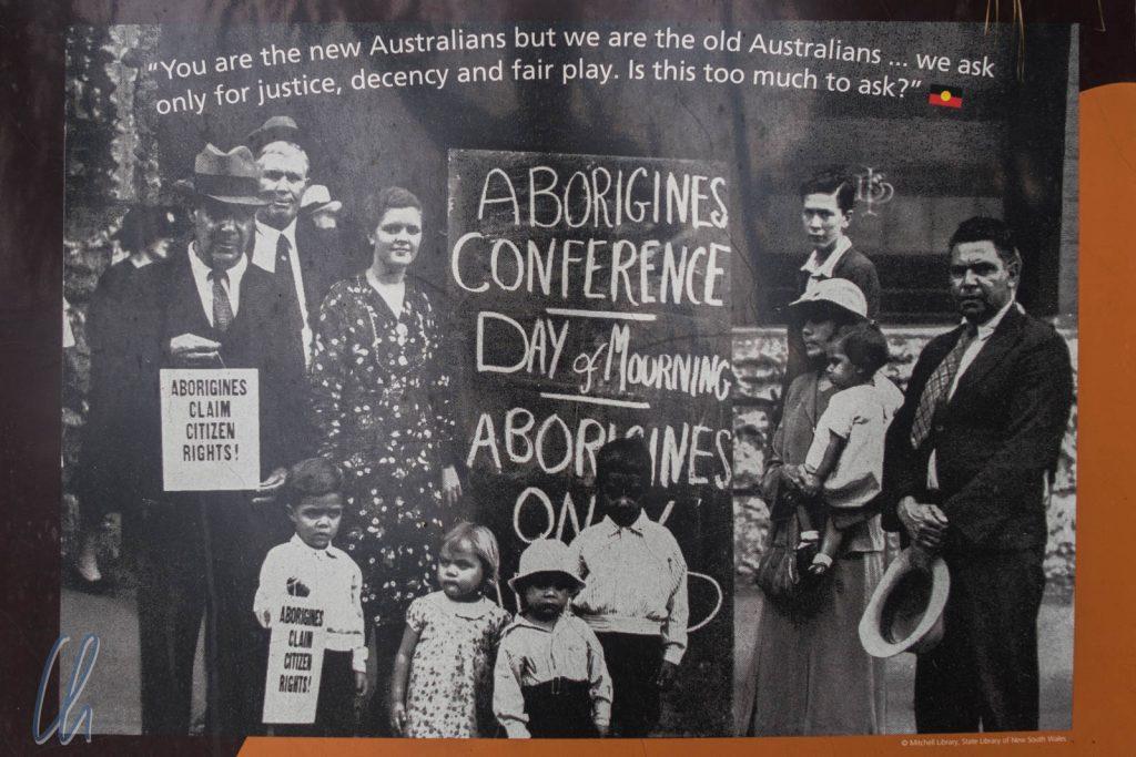 Die ersten Einwohner Australiens kämpfen um ihre Rechte und Forderungen (Plakat aus dem Botanischen Garten in Sydney)