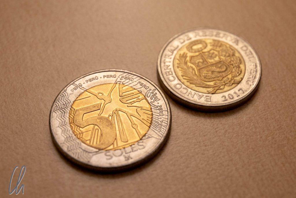 Nazca-Kolibri oder Wappen? Das ist die Auswahl beim Soles-Münzwurf.